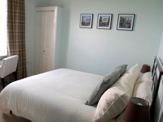 the Brae Lodge Double room is on the first floor and is facing the rear of the guest house